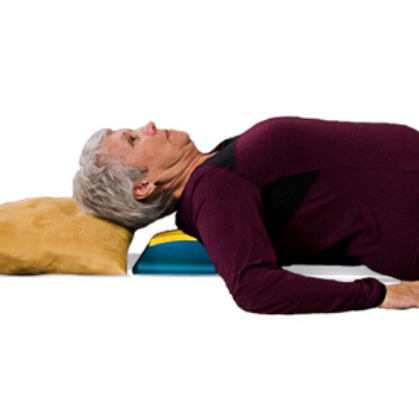 Older Woman Using Spine-Worx Device